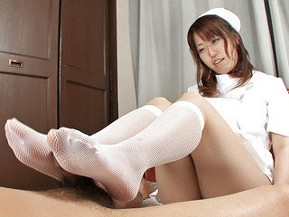 Nurse Ai Ootomo gives her patient a foot and  job