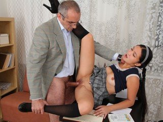 This Japanese college girl is liking the attention from her instructor
